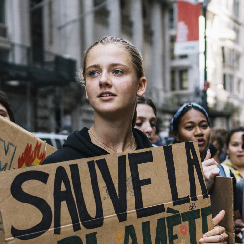 From lef to right, Litokne Kabua, Iris Duquesnee, and Carl Smith at the climate strike in New York City, September 20, 2019.  they are sixteen young people from around the world who brought a legal complaint about climate change to the United Nations. Their petition outlines how their human rights are being violated by the failure of nations to seriously address the climate crisis. Earthjustice and global law firm Hausfeld are representing the 16 youths in this matter. Petitioners attended the global climate strike on Sept. 20, 2019 in New York and then events throughout the weekend, culminating in a petition delivery on Sept. 23, 2019.